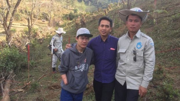 Peter Kim, left, and members of HI's mine clearance team in Laos ; }}